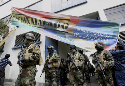 Bolivian police officers stand guard in front of the headquarters of electricity distribution company Electropaz, a subsidiary of the Spanish energy company Iberdrola, after President Evo Morales announced their nationalization in La Paz